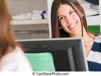 Female Cashier At Counter