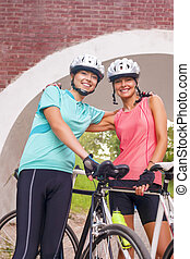 Happy Female Caucasian Cyclists Standing Outdoors Smiling