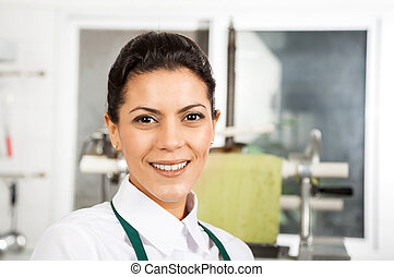 Happy Female Chef At Kitchen