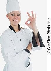 Happy female chef gesturing ok sign