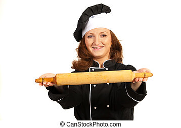 Happy female chef holding rolling pin