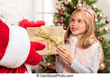 Happy female child getting Christmas present