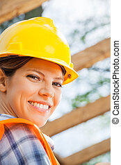 Happy Female Construction Worker At Site