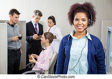 Happy Female Customer Service Representative Wearing Headphones