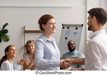 Happy female employee intern handshake helpful boss get rewarded promoted