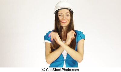 Happy female engineer or architect dancing against white background. 4K video