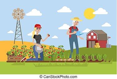 Happy female farmers watering vegetables