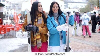 Happy female friends at a winter ski resort