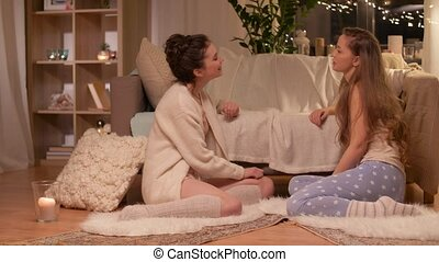 happy female friends at home pajama party - friendship,...