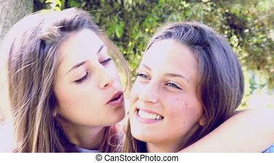 Happy female friends hugging
