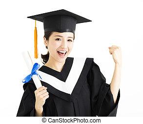 Happy female graduate student holding diploma