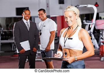 happy female gym trainer portrait