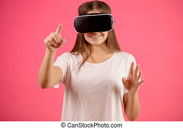 female in casual clothes interacting with virtual features