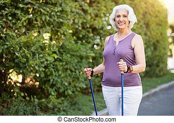 Happy female in sporty wear getting ready for morning walk