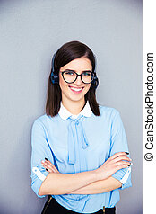Happy female operator with phone headset