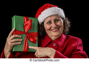 Happy Female Pensioner Pointing at Wrapped Gift