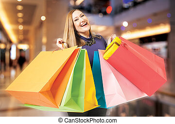 happy female shopping mall - Happy xxl female holds shopping...
