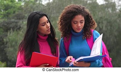 Happy Female Students Reading Notes