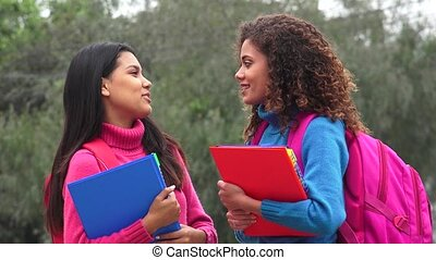 Happy Female Students Talking