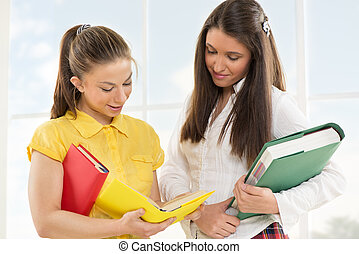Happy Female students with books