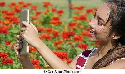 Happy Female Teen Girl Using Tablet
