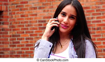 Happy Female Teen Student Talking On Cell Phone