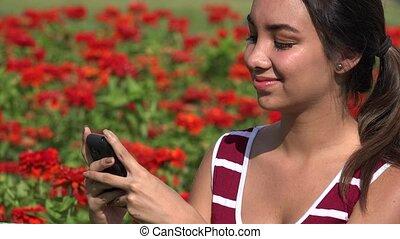 Happy Female Teen Using Wifi Smartphone