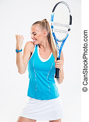 Happy female tennis player celebrating her success