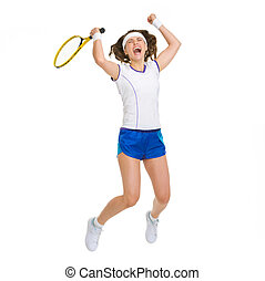 Happy female tennis player jumping