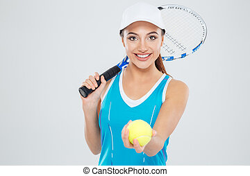 Happy female tennis player looking at camera
