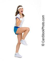 Happy female tennis player rejoicing success