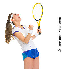 Happy female tennis player with racket rejoicing success