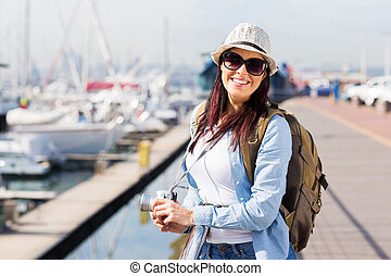 happy female tourist at the harbour