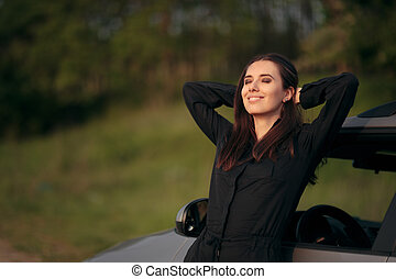 Happy Female Tourist Driver Next to Her Car