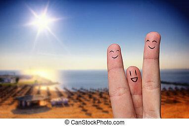 Happy finger hug on beach