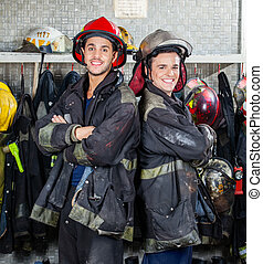 Happy Firefighters Standing Arms Crossed