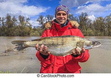 Happy fisherman with big fish. Fishing. Fish perch. Trophy.