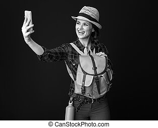 happy fit tourist woman taking selfie with mobile phone