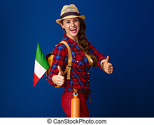 happy fit tourist woman with flag of Italy showing thumbs up