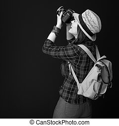 happy fit tourist woman with modern DSLR camera taking photo
