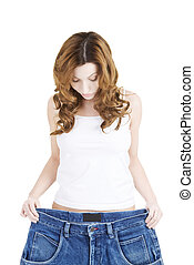 Happy fit woman with big pants
