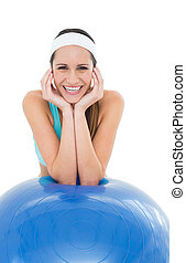 Happy fit young woman with fitness ball