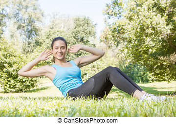 Happy fitness girl doing exercise