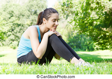 Happy fitness girl relaxing