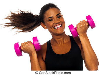 Happy fitness woman lifting dumbbells - Cheerful woman ...