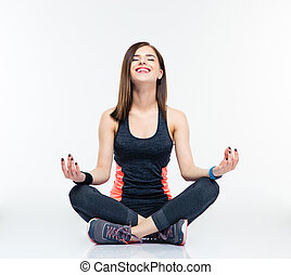 Happy fitness woman meditating