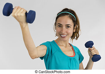 Happy fitness woman with dumbbells