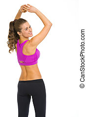 Happy fitness young woman making exercise
