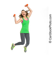 Happy fitness young woman with dumbbells jumping