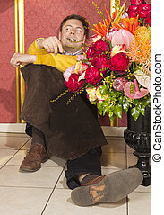 Happy florist resting after hard wo